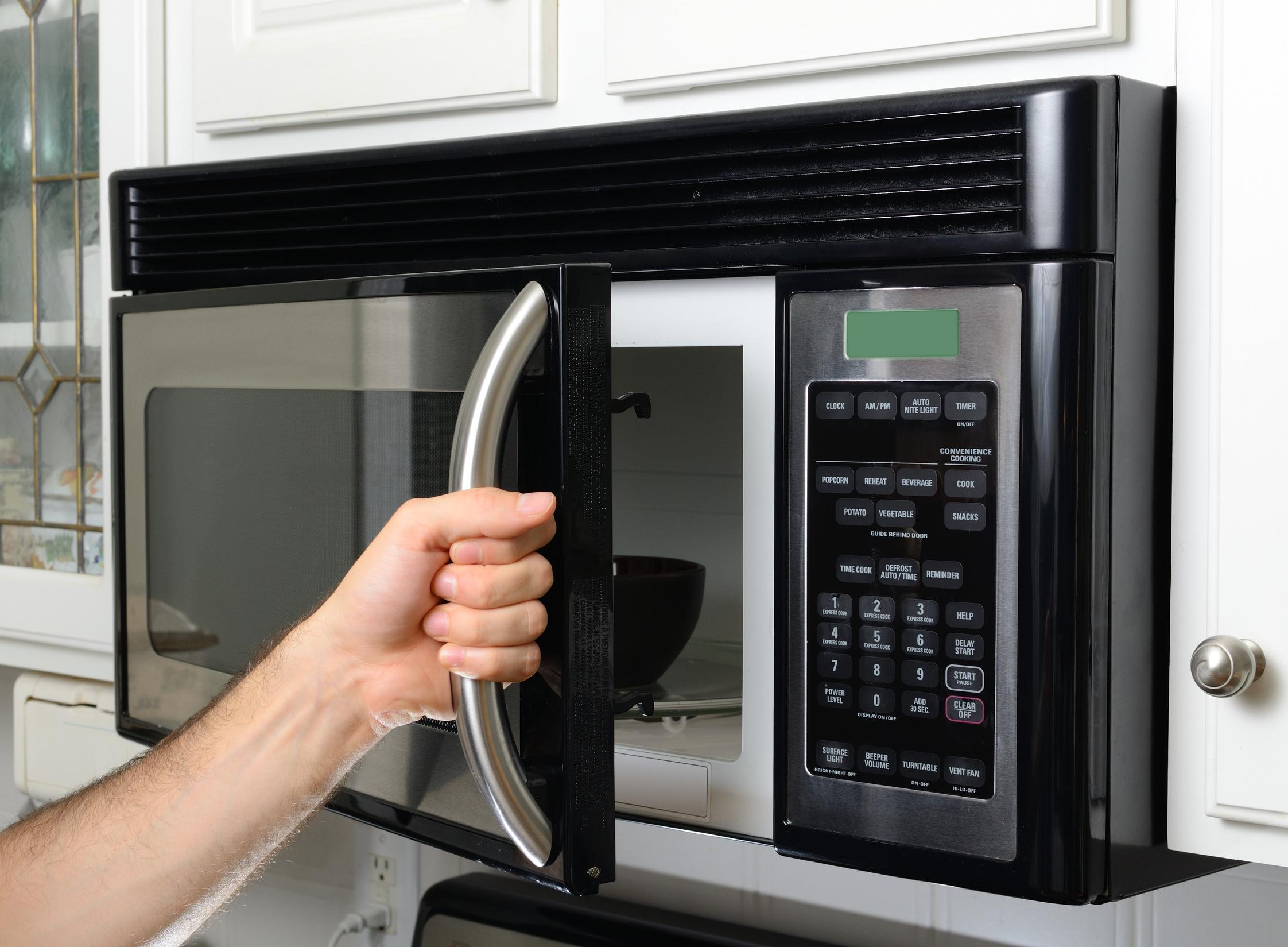 opeing a microwave door